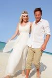 Couple At Beautiful Beach Wedding. Smiling stock photos