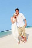 Couple At Beautiful Beach Wedding. Smiling royalty free stock image