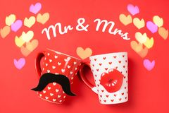Couple of beautiful cups on red royalty free stock photos