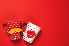 Couple of beautiful cups on red stock photography