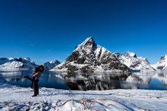 Couple posing in the mountains of the Lofoten Islands. Reine, Norway royalty free stock images