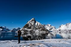 Couple posing in the mountains of the Lofoten Islands. Reine, Norway royalty free stock photography