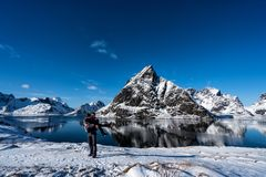 Couple posing in the mountains of the Lofoten Islands. Reine, Norway royalty free stock photos