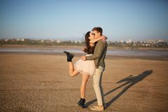 Young, cute amorous couple on a natural background. Romantic traveling concept. Copy space. Stock Photos