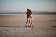 Young, cute amorous couple on a natural background. Romantic traveling concept. Copy space. stock photo
