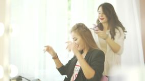 Couple of beautiful young women hairdresser stylist model dancing preparing for party celebration making salon hairstyle. Couple beautiful young women stock footage