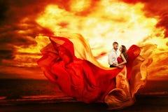 Couple Beauty, Man Dancing with Beautiful Woman on Sea Beach in Sunset Light, Waving Dress
