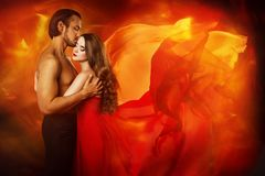 Couple Beauty Portrait, Kissing Man in Love and Seductive Dreaming Woman. In Waving Fantasy Dress stock photos