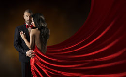 Couple Beauty Portrait, Man in Suit Woman Red Dress, Rich Gown. Couple Beauty Portrait, Man in Suit Woman in Red Dress, Rich Lady in Gown, Waving Silk Fabric Stock Photography