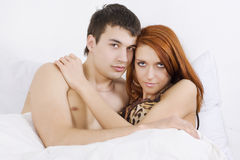 Couple on bed Royalty Free Stock Image