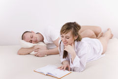 Couple in the bed Royalty Free Stock Image