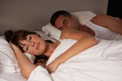 Couple in bed asleep. Next to each other Stock Images