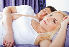 Couple bed awake thinking Stock Photo