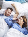 Couple at the bed stock photography
