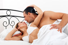 Couple in bed in bedroom Stock Image