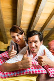 Couple with bed clothes in mountain cabin Stock Photos