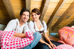 Couple with bed clothes in mountain cabin Stock Photo