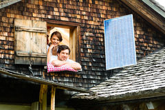 Couple with bed clothes in mountain cabin Royalty Free Stock Images