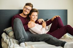 Couple on a bed at home Stock Images