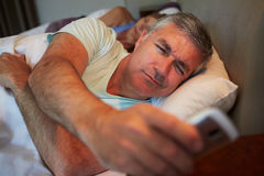 Couple In Bed With Husband Suffering From Insomnia Stock Images