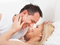Couple on bed looking at each other Royalty Free Stock Image