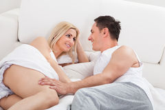Couple On Bed Looking At Each other Stock Photography