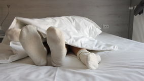 Couple in bed. male and female legs top view, white linens. stock video