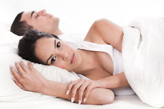 Couple in bed, men sleeping and woman lying. Sleepless in white background Stock Photos
