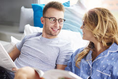 Couple at the bed Royalty Free Stock Photos