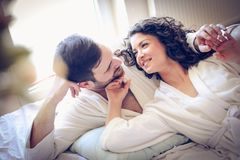 Couple in bed. Morning routine. royalty free stock photo