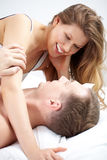 Couple in bed. Portrait of a happy couple stroking in bed Royalty Free Stock Photos