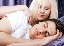 Couple bed sleeping awake Royalty Free Stock Photo