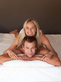 Couple on bed smiling Stock Photo