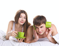 Couple in a bed with tea cups Stock Photography