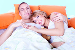 Couple in bed are trying to sleep. Studio shot Stock Photo