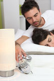 Couple in bed waking up Royalty Free Stock Image