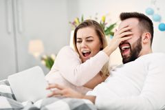 Couple in bed watching TV. Picture showing couple in bed watching TV Royalty Free Stock Image