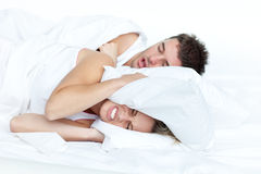Couple in bed while the woman is trying to sleep. And the man is snoring Royalty Free Stock Photo