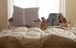 Couple in bed Royalty Free Stock Images