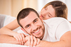 Couple in bed stock images
