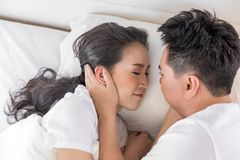 Couple in bed. Young loving couple in the bed. Modern lifestyle concept Stock Image