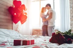 Couple in bedroom Stock Photography