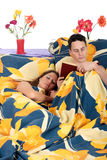 Couple bedroom book sleeping Stock Images