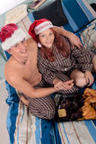 Couple bedroom breakfast Xmas Stock Images