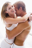 Couple bedroom embracing and smiling Royalty Free Stock Images