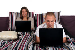 Couple, bedroom laptop Stock Photography