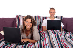 Couple, bedroom laptop Royalty Free Stock Photos