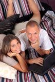 Couple, bedroom laptop Stock Photos