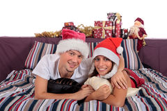Couple bedroom Xmas morning Stock Photos