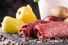 Couple of beef slices prepared for roulade with green peppers Royalty Free Stock Photography